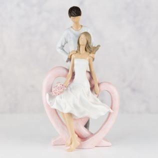 Resin Figurine - Man Holding Lady with Flowers Product Image