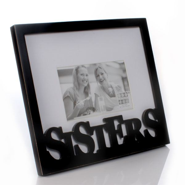 carved wood sisters frame