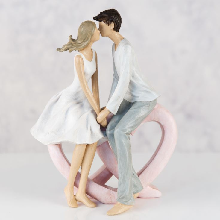 Resin Figurine - Couple Sitting Kissing Single Heart product image