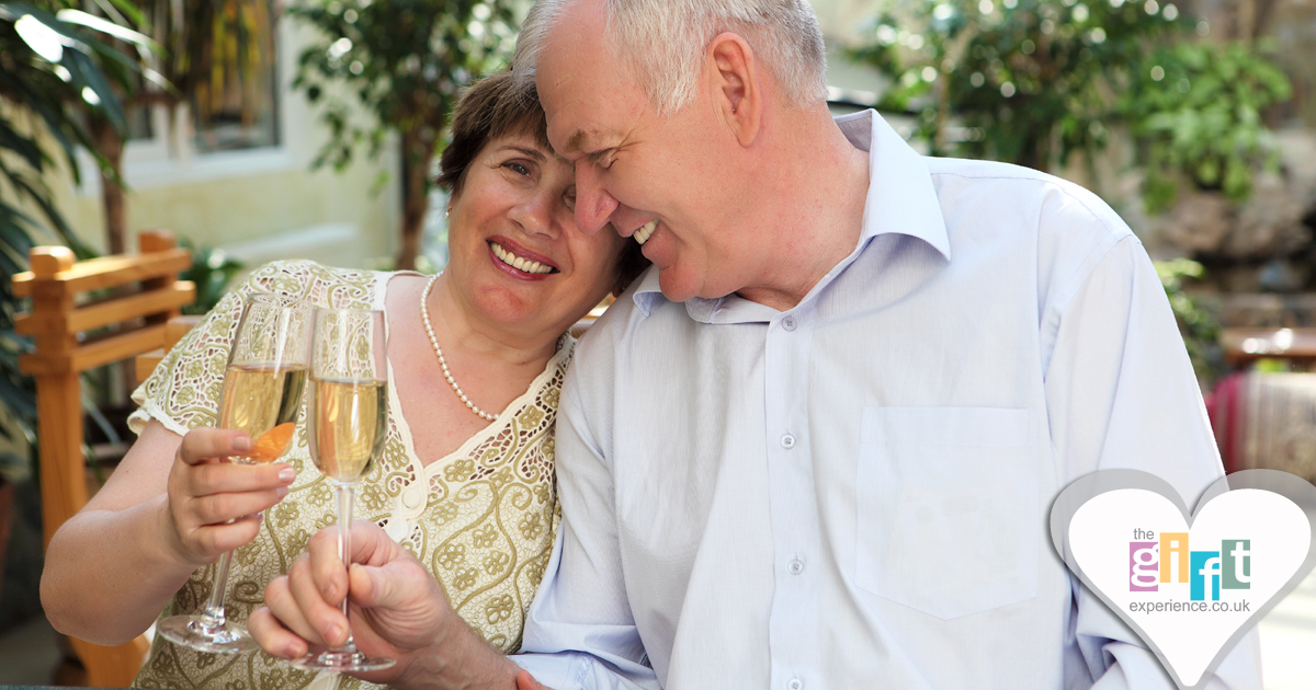 A couple celebrating their anniversary with a glass of wine