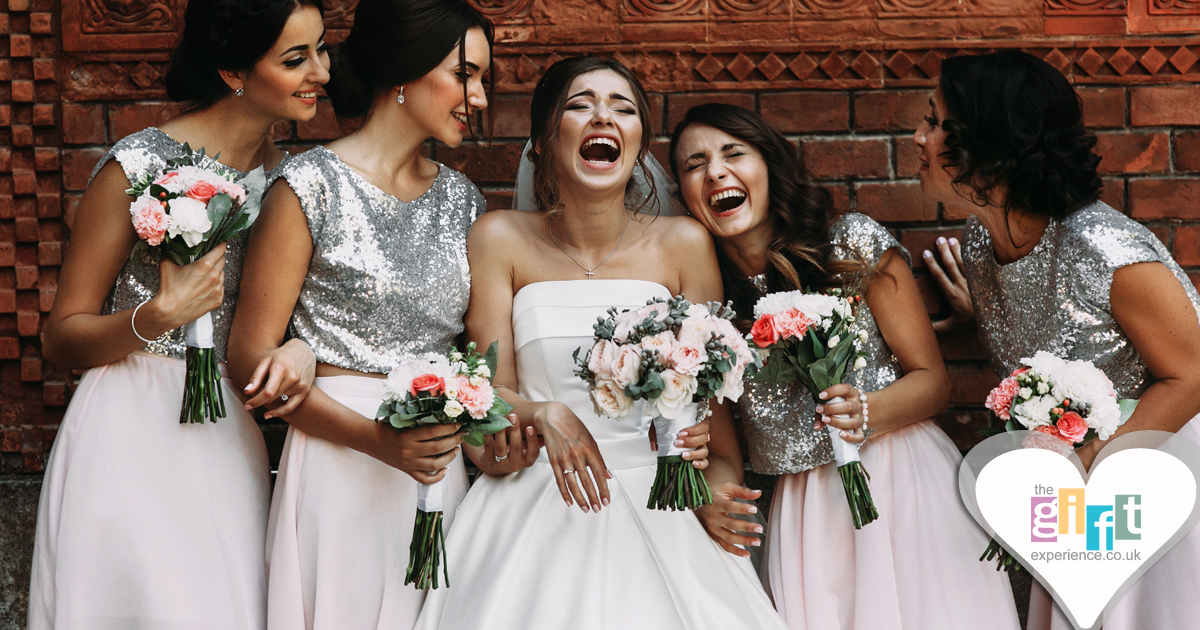 Bride and bridesmaids enjoying the wedding day