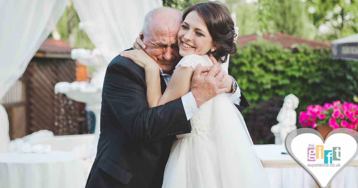 Bride hugging her dad on her wedding day