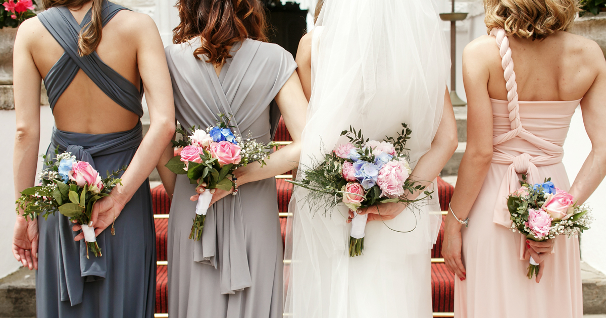 Bridesmaids in their mis-matched bridesmaid dresses