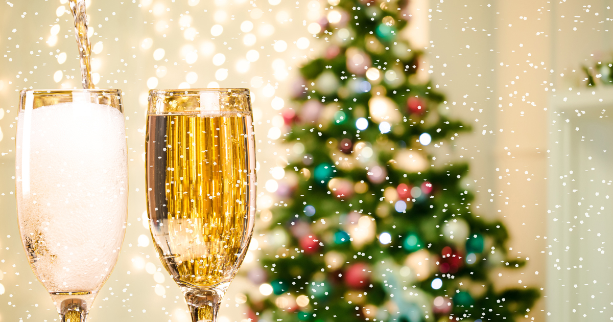 Champagne in front of a Christmas Tree