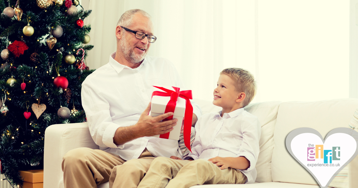 A child giving his dad a Christmas gift