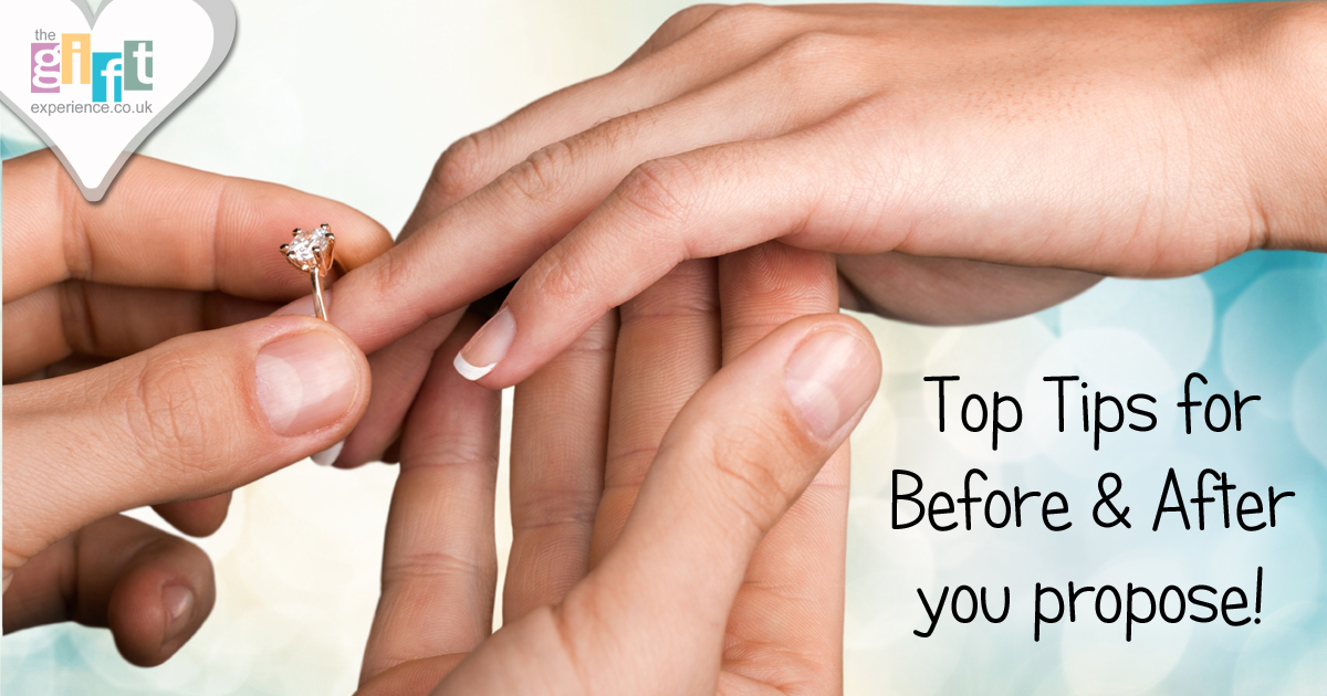 Hands putting on an engagement ring