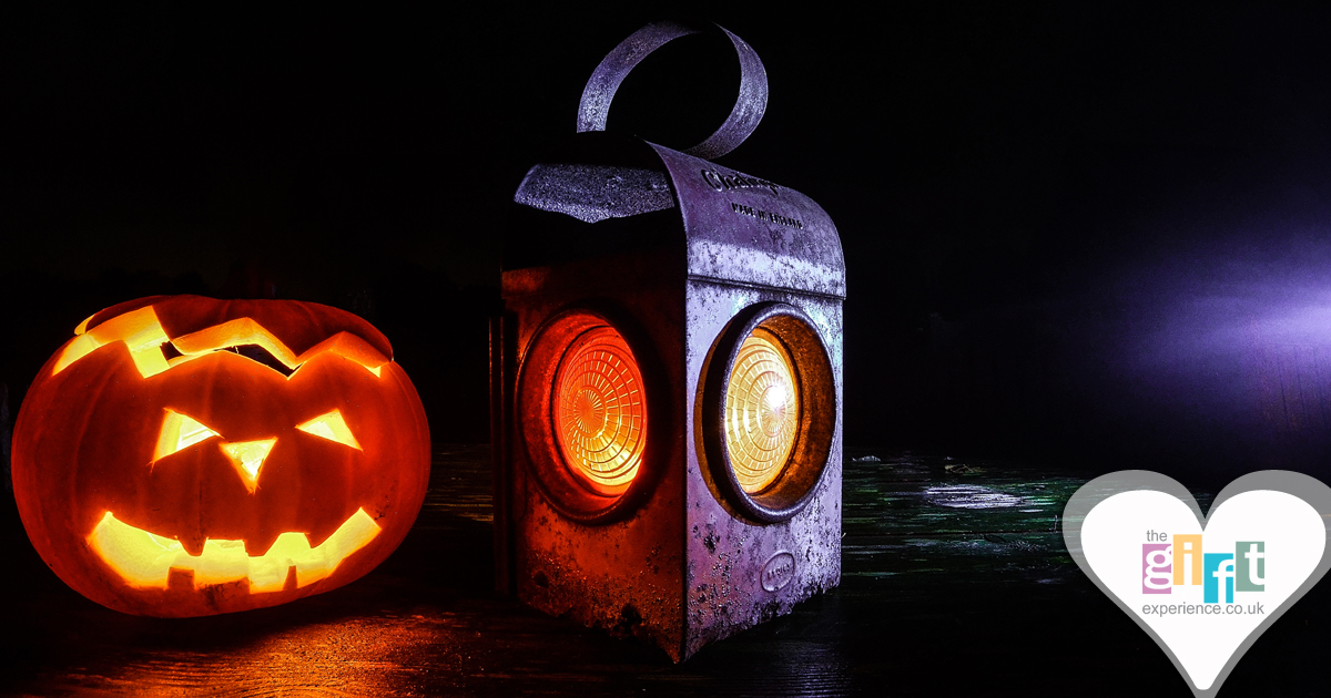 A pumpkin and a Halloween lantern