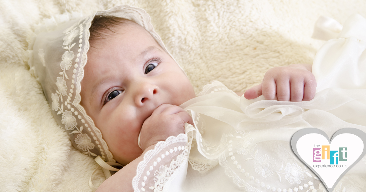 a baby in a christening gown