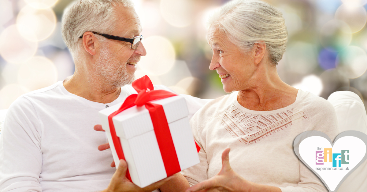 a couple celebrating their anniversary by exchanging gifts
