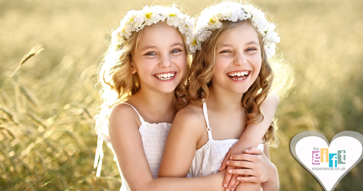 Two pretty flower girls playing and smiling