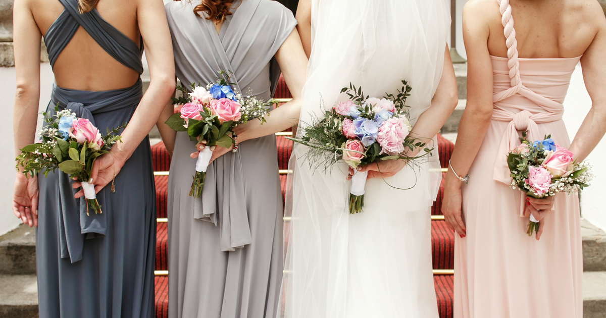 Bride and Bridesmaids holding their bouquets and about to walk down the aisle