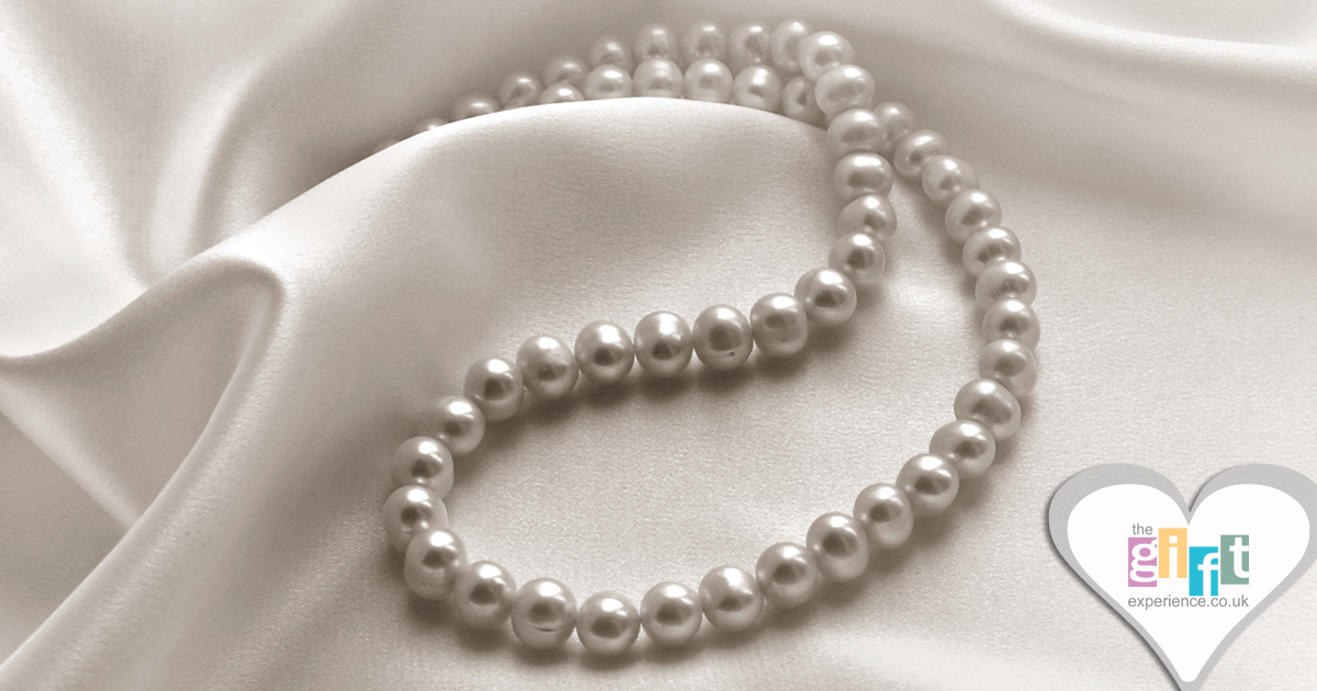 pearl necklace on cream silk
