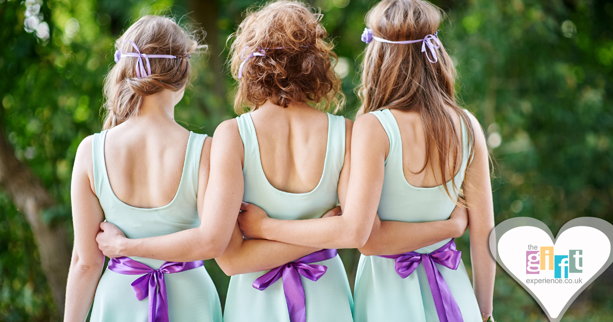 Three bridesmaids in matching wedding attire