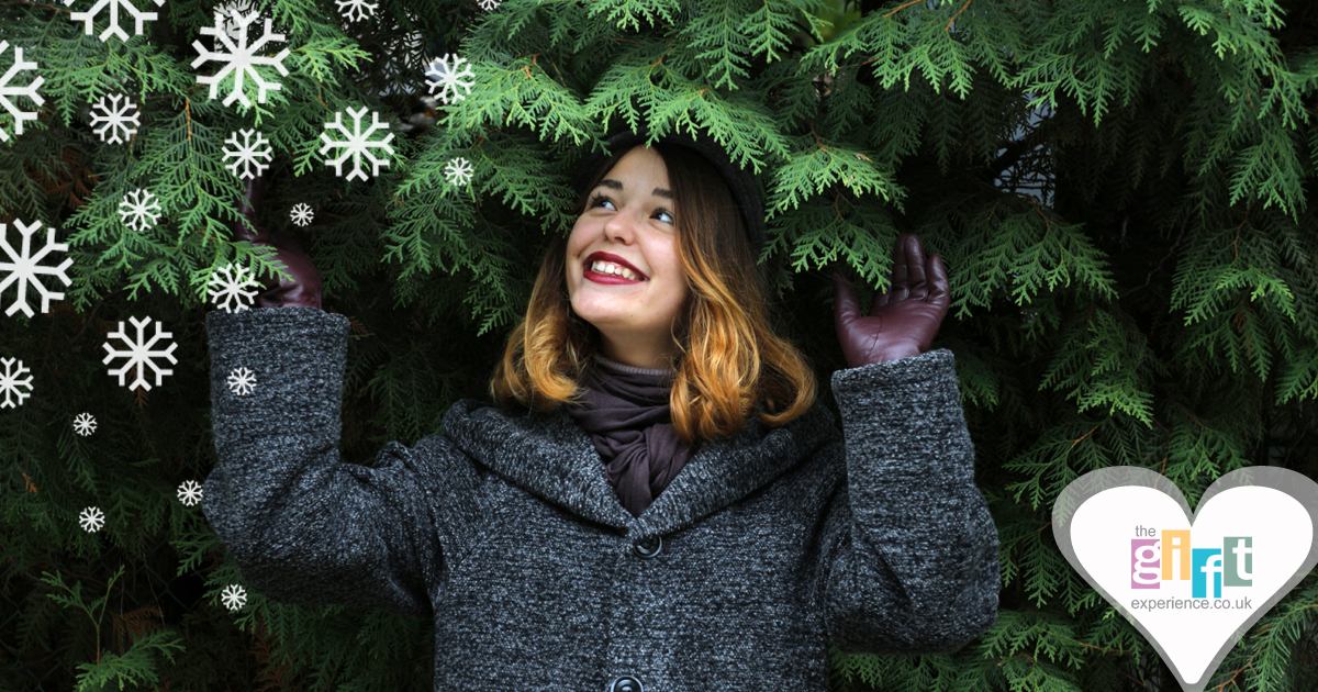 Woman by a Christmas tree with snow